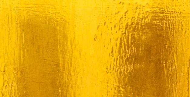 Glänzender gelber blattgoldfolienbeschaffenheitshintergrund