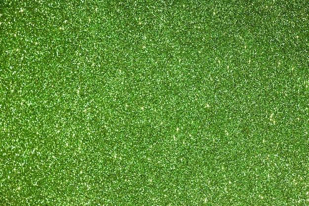 Glänzender grüner foamiran hintergrund mit funkelneffekt