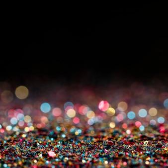 Glänzender mehrfarbiger glitzer mit kopierraum