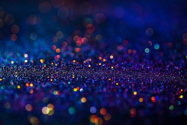 Glänzender mehrfarbiger glitzer-rasterhintergrund. abstrakter schimmernder dekorativer hintergrund der rosa, blauen, gelben kreise.