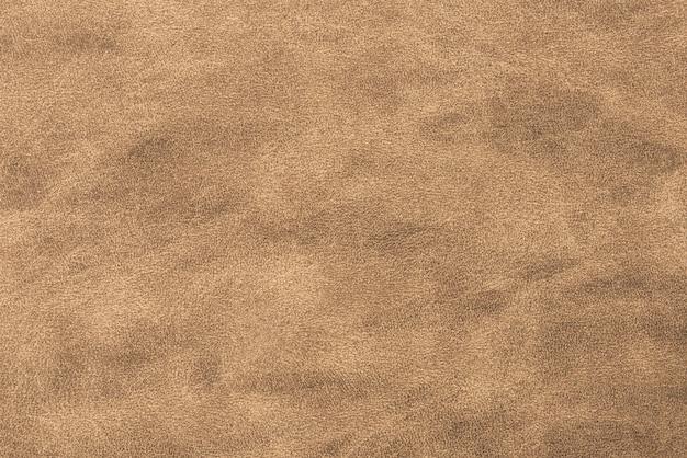 Glänzender strukturierter papierhintergrund der bronze