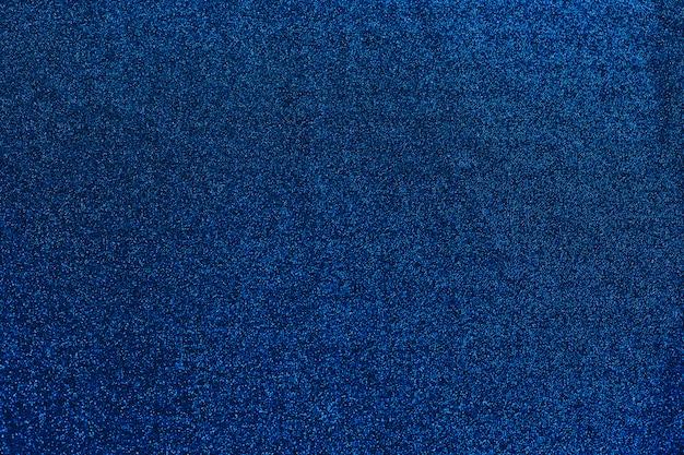 Glänzender textilhintergrund des blauen himmels. weihnachten abstrakten hintergrund