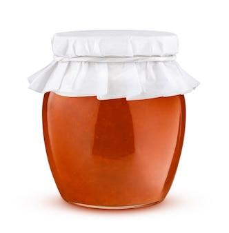 Glas aprikosenmarmelade isoliert auf weißem hintergrund