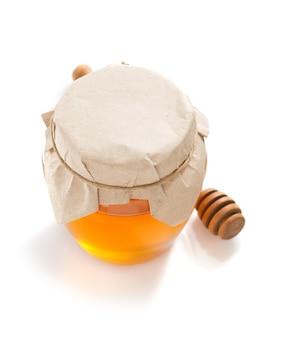 Glasglas honig lokalisiert auf weiß