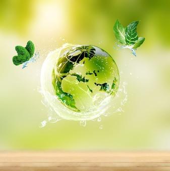 Glaskugel auf grünem moos im naturkonzept für umwelt und naturschutz mit schmetterling