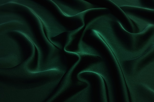 Glatte elegante grüne stoffstruktur aus grüner seide oder satin