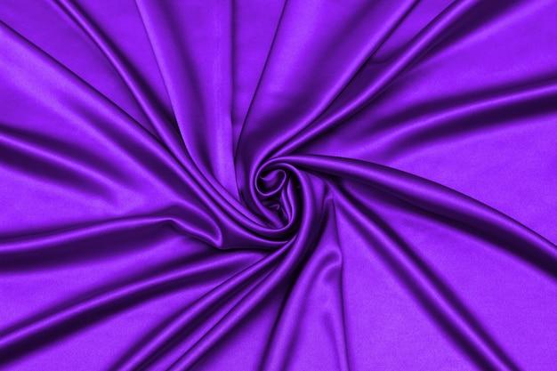 Glatte elegante lila seide oder satin luxus stoff textur kann als abstrakter hintergrund verwendet werden.