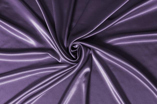Glatte elegante seiden- oder satin-luxus-stoffstruktur kann als abstrakter hintergrund verwendet werden.
