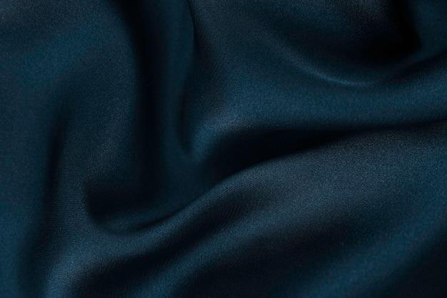 Glatte, elegante seiden- oder satin-luxustuchtextur kann als hochzeitshintergrund verwendet werden. luxuriöses hintergrunddesign.