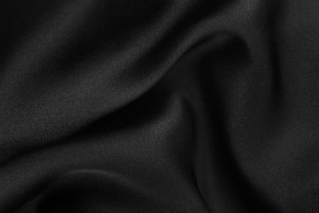 Glatte, elegante seiden- oder satintextur kann als abstrakter hintergrund verwendet werden. luxuriöses hintergrunddesign