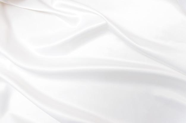Glatte elegante weiße seide oder satin textur. luxuriöses hintergrunddesign