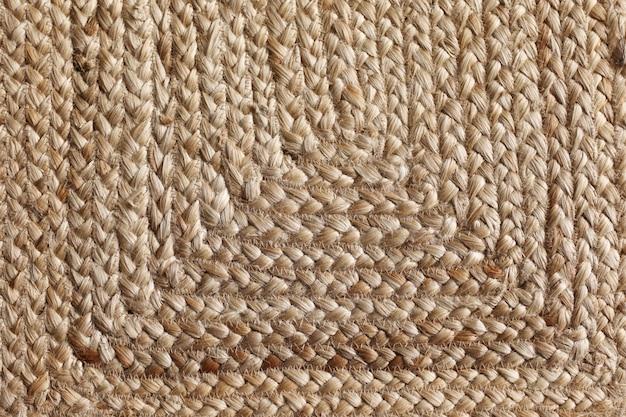 Glatte textur am boden des weidenstrohkorbs. extreme nahaufnahme einer vintagen weidenstruktur.
