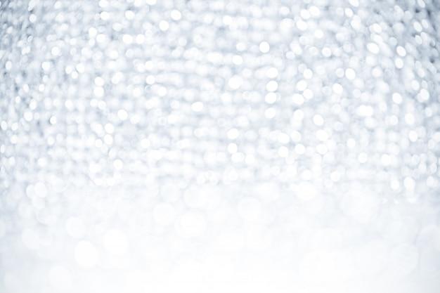Glister bokeh hintergrund der abstrakten silbernen weißen lichter