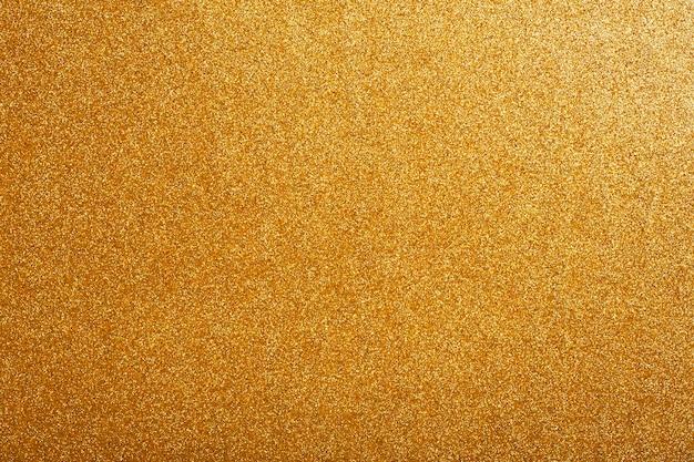 Glitter goldener hintergrund goldener festlicher heller glamouröser hintergrund