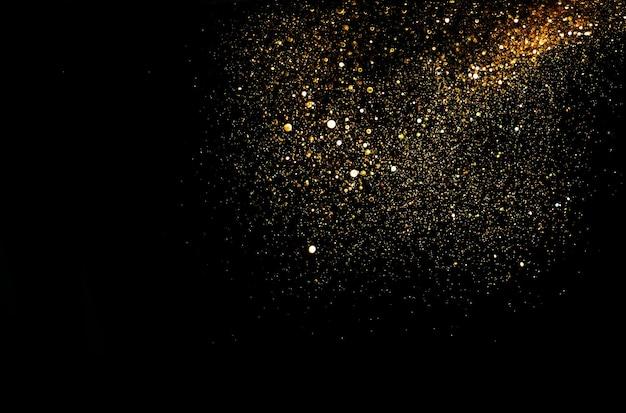 Glitter vintage lichter hintergrund. gold und schwarz. de fokussiert