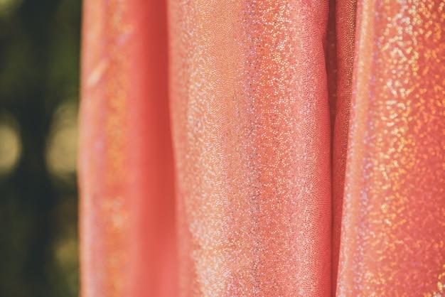 Glitzer pailletten rosa. rosa, texturhintergrund glänzender hintergrund
