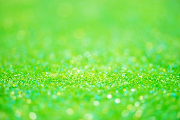 Glitzerlicht abstraktes grünes bokehlicht verschwommener hintergrund
