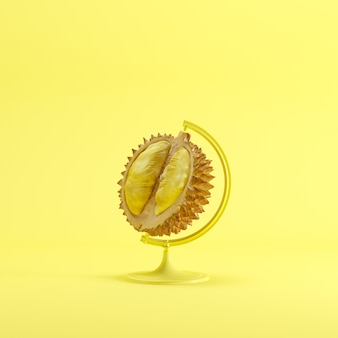 Globales ideenkonzept durian auf gelbem farbpastellhintergrund.