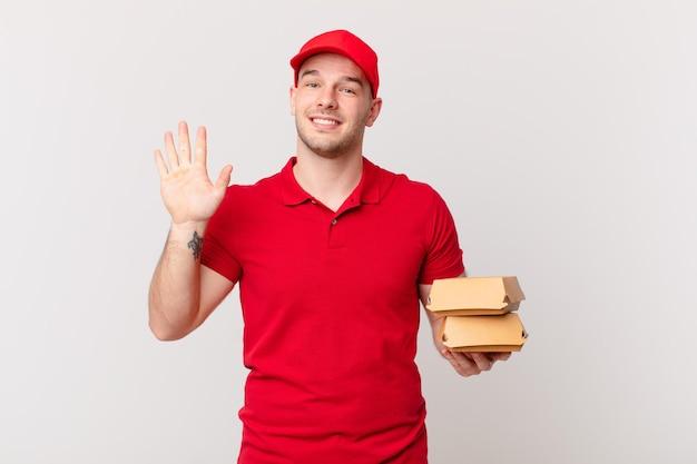 Glücklich und fröhlich lächeln, mit der hand winken, dich begrüßen und begrüßen oder dich verabschieden