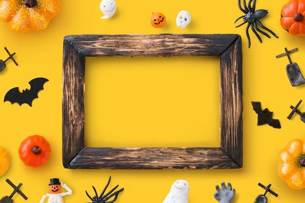 Glückliche halloween-dekoration und draufsicht des rahmens.