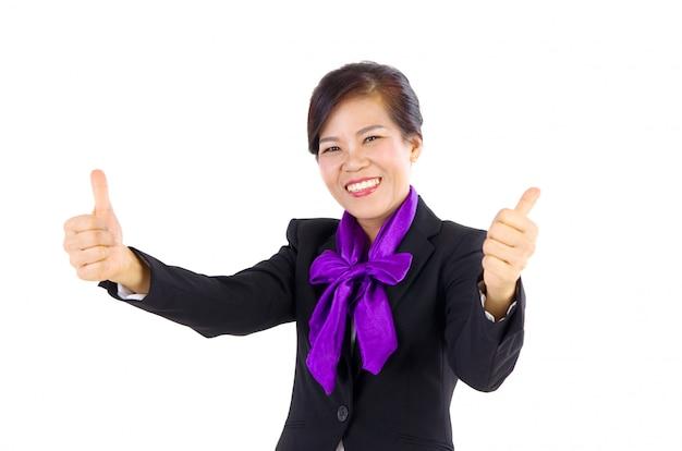 Glückliche mittlere gealterte geschäftsfrau mit dem daumen oben