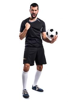 Glücklicher fußballspieler