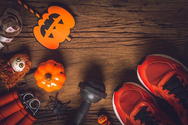 Glücklicher halloween-tag mit eignung, übung, gesundes lebensstilkonzept ausarbeitend.