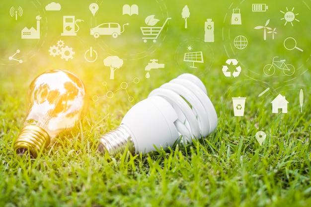 Glühbirne im grünen gras, save earth-konzept