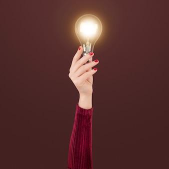 Glühbirne kreatives geschäftsideensymbol, das von einer hand gehalten wird