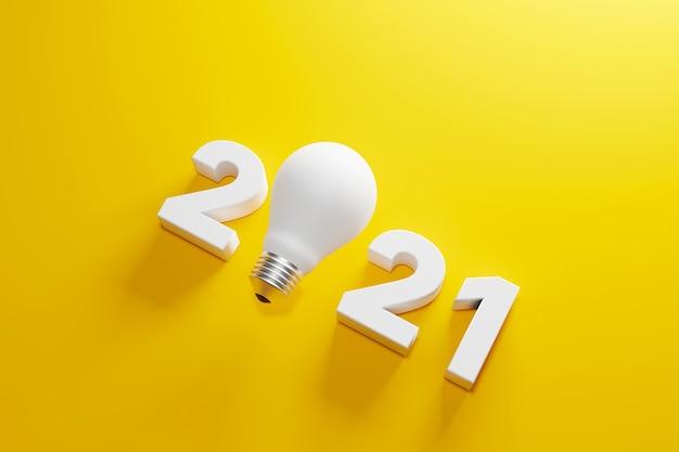 Glühbirne und 2021 neujahr auf gelbem hintergrund geschäftslösung und planung