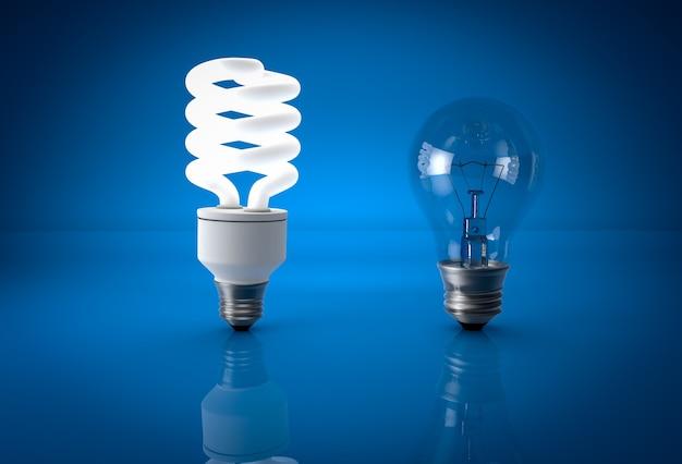 Glühende öko-energiesparlampe und tote glühbirne über blauem hintergrund