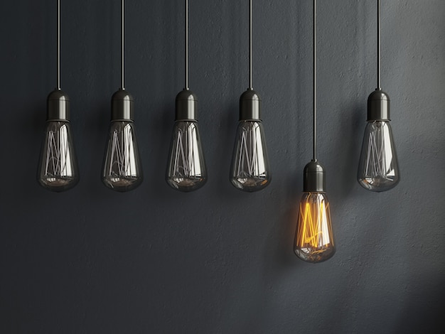 Glühendes licht des lampenideenkonzeptes auf blac