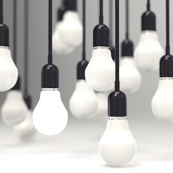 Glühlampe des kreativen ideen- und führungskonzeptes auf grau