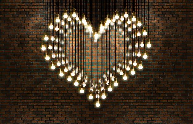 Glühlampenherz, dachbodenart, valentinsgruß und liebeskonzept.