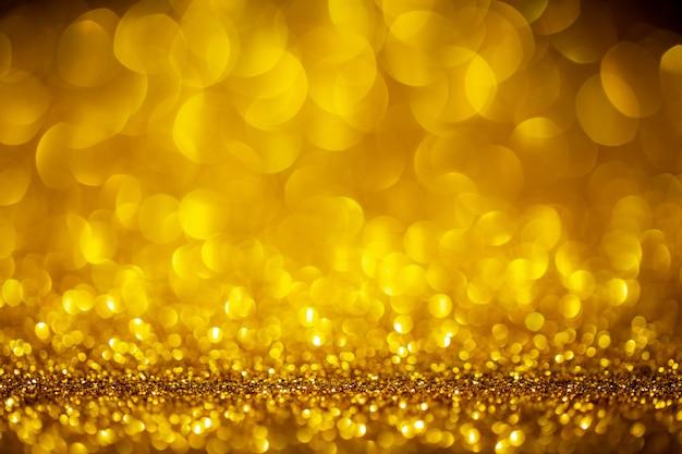 Gold abstrakter raum mit bokeh defokussierten lichtern