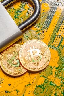 Gold bitcoin und vorhängeschloss