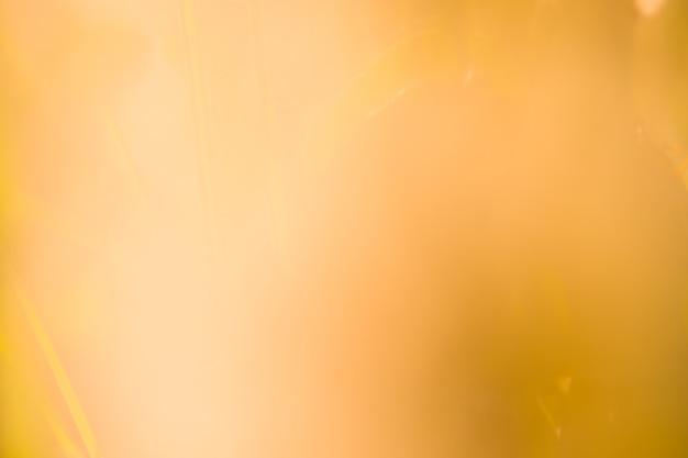 Gold bokeh hintergrund. abstraktes unschärfegold-bokeh. funkelnweinlese beleuchtet hintergrund