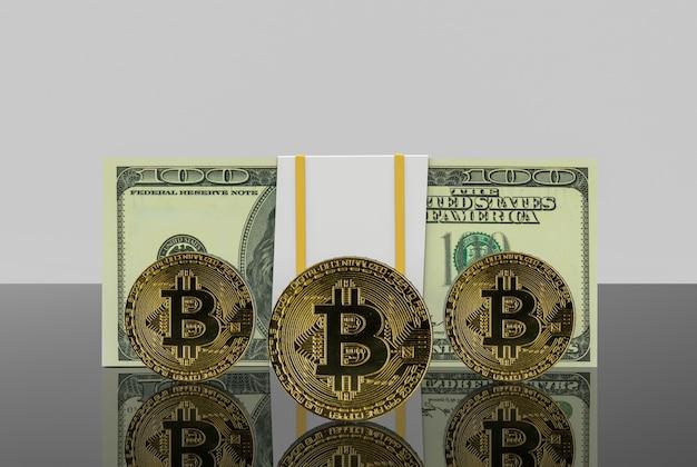 Gold cryptocurrency bitcoin und us daollar banknote auf grauem kopienraumhintergrund