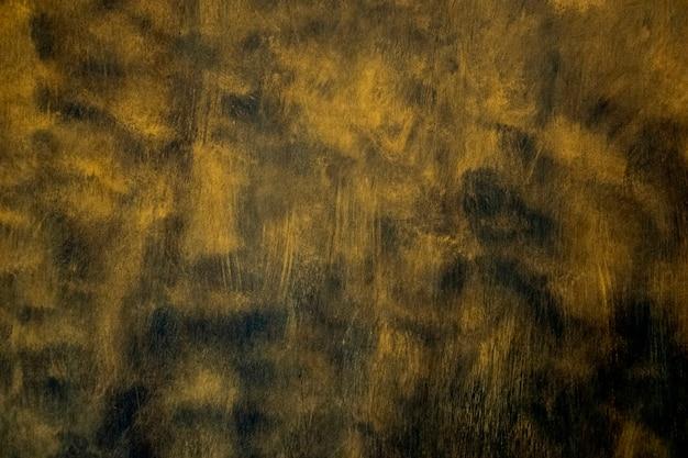 Gold textur. handgezeichneter pinselstrich auf schwarz.