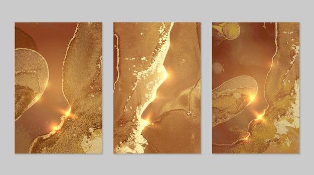 Gold- und bronzehintergründe mit textur des abstrakten marmorvektors in flüssiger kunst der alkoholtinte
