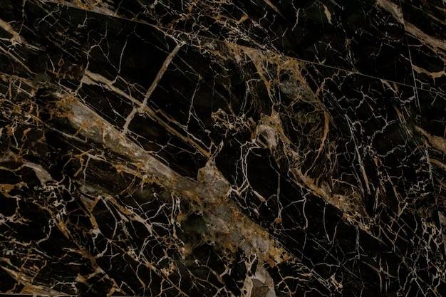 Gold und weiß gemusterte natürliche von dunkelgrauer marmorstruktur