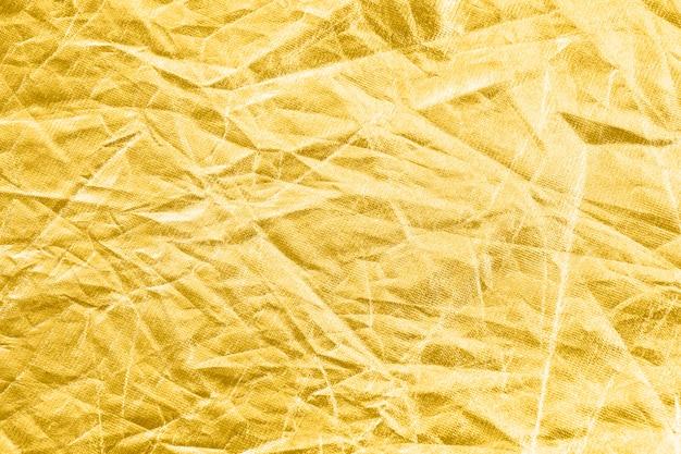Gold zerknitterter folienhintergrund