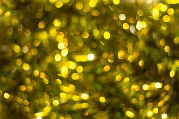 Goldabstrakter hintergrund mit bokeh defocused lichtern