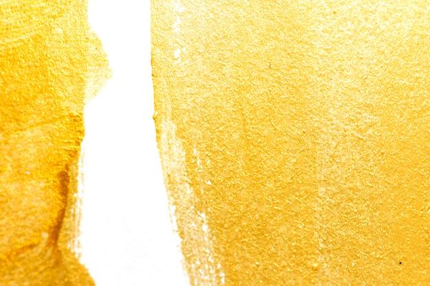 Goldacrylfarbenbeschaffenheit auf weißbuchhintergrund
