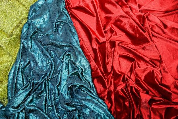 Goldblauer und roter gewebebeschaffenheitshintergrund