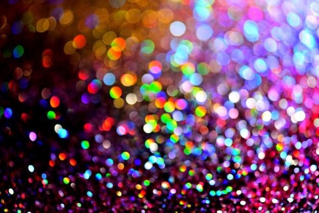 Golden glitter textur colorfull unscharfer abstrakter hintergrund für silvester oder weihnachten geburtstag