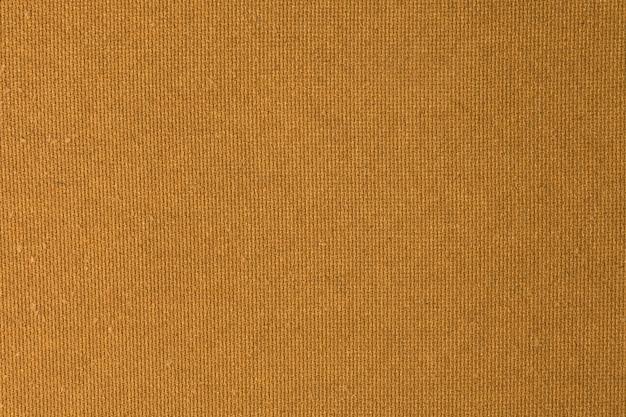 Goldene braune oberflächensperrholz-hintergrund-beschaffenheit in horizontalem