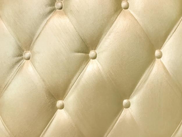 Goldene dekorative innenwand 3d mit capitone-muster.