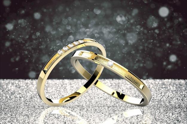 Goldene eheringe auf silbernem glitzerhintergrund