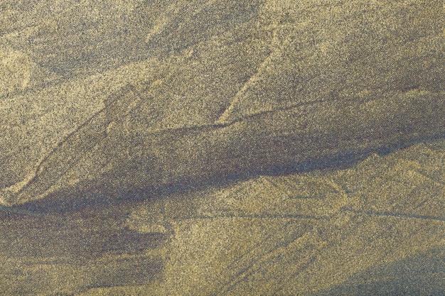 Goldene farbe des hintergrundes der abstrakten kunst. mehrfarbenmalerei auf segeltuch.